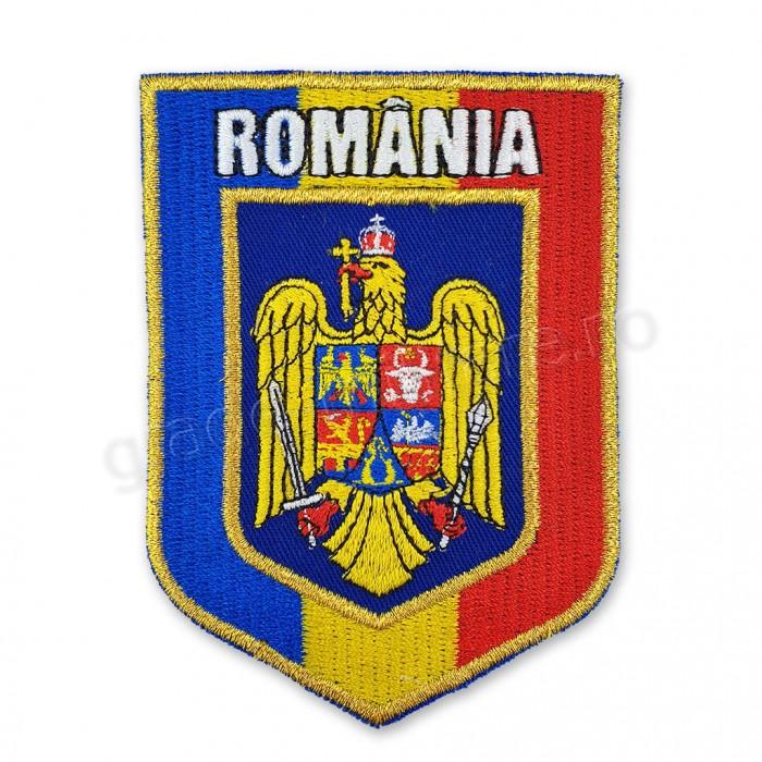 Emblema Stema Romaniei incadrata in drapel